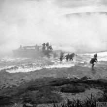 THE BRITISH ARMY IN THE UNITED KINGDOM 1939-1945 (H 14597) Troops coming ashore from a landing craft under a smoke screen during Combined Operations training at Inveraray, Scotland. Copyright: © IWM. Original Source: http://www.iwm.org.uk/collections/item/object/205214998
